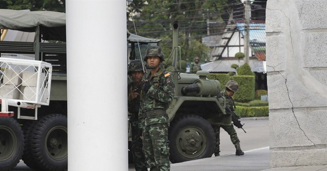 Thai army: Ex-PM, protest leaders held 'to think'