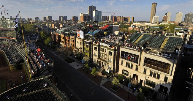 Cubs to proceed with Wrigley plan, risk lawsuits