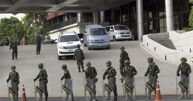 After coup, Thai army summons Shinawatra family