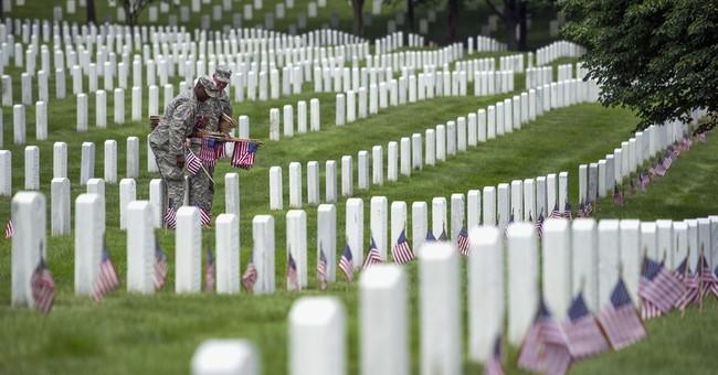 AP PHOTOS: Old Guard places flags at Arlington