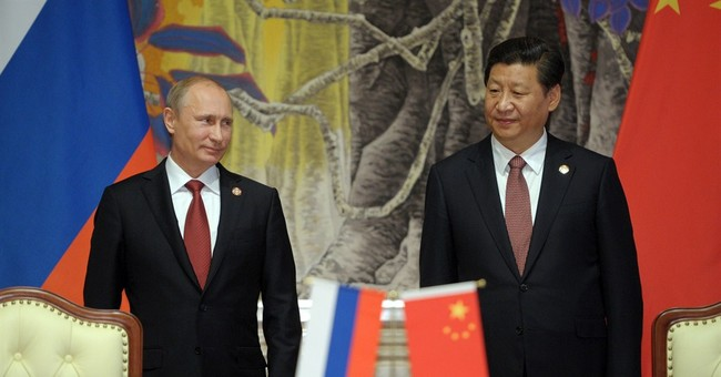 Analysis: US plays down warming China-Russia ties