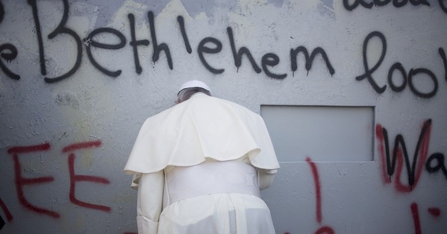 AP PHOTOS: In West Bank, pope makes surprise stop