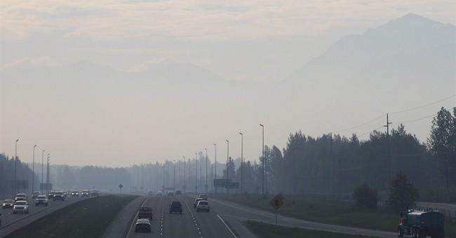 Alaska wildfire grows, spurs evacuations