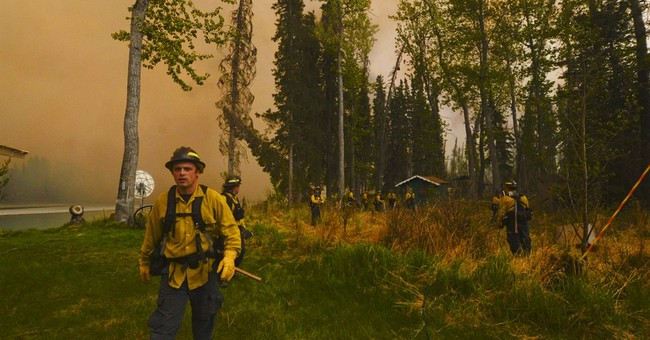 Alaska wildfire keeps growing after evacuations