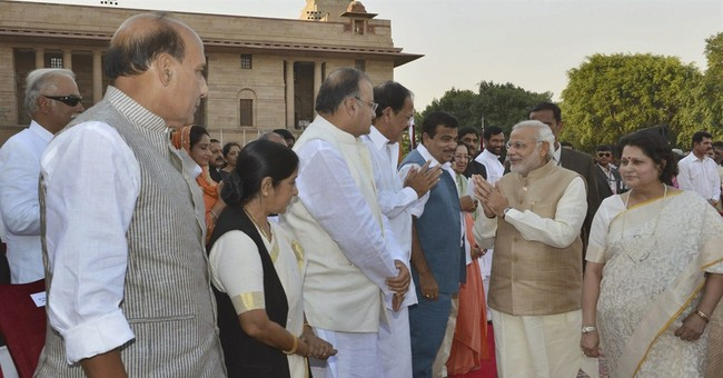 Modi becomes Indian PM as Pakistani leader watches