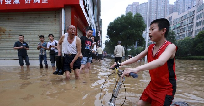 Week of flooding in southern China kills 37
