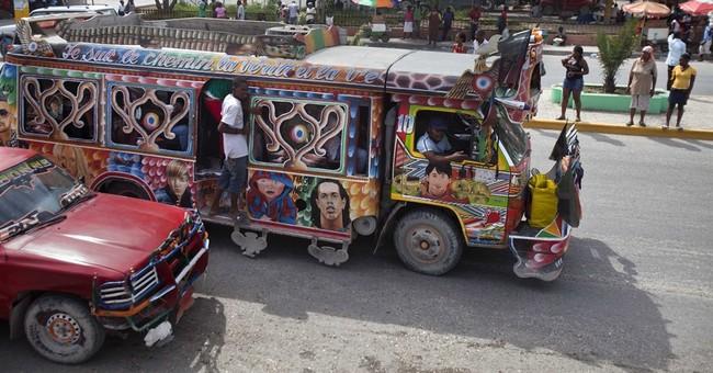 AP PHOTOS: Soccer stars decorate Haiti's minibuses