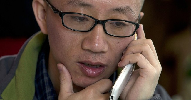 China hits activists with common-crime charges