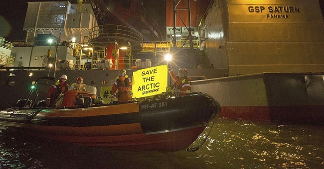 Greenpeace boards 2 drill rigs in Arctic protest