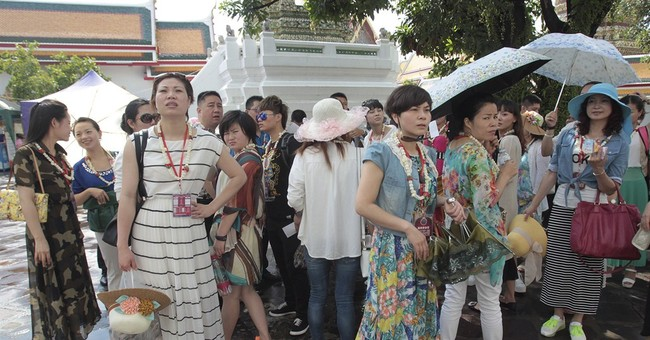 From beaches to Bangkok, tourists ask 'What coup?'