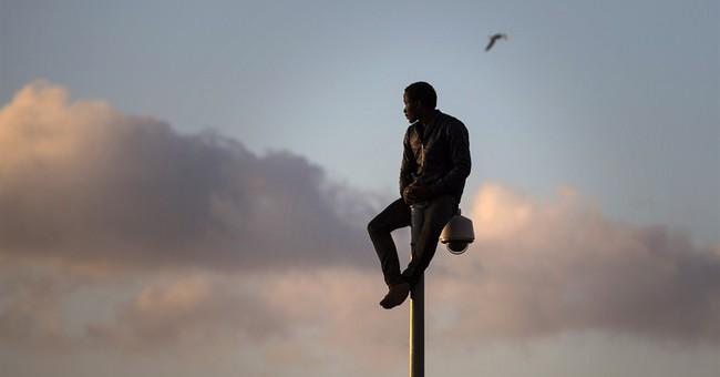 Hundreds of migrants rush Spain's border
