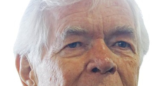 Senator says use of ill wife's photo 'amateurish'