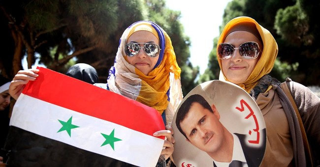 Assad's supporters abroad vote in Syrian election