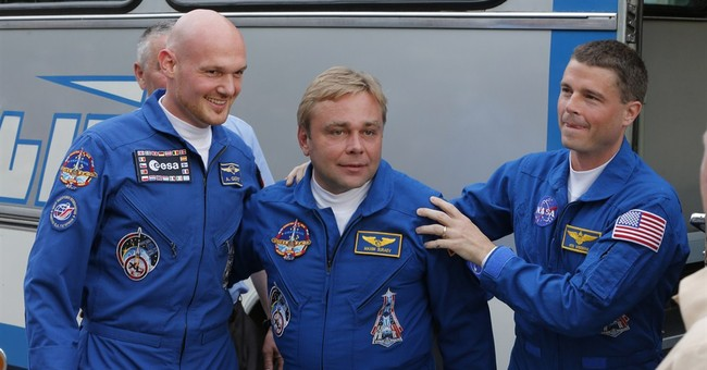 Spaceship with 3-man crew docks at space station