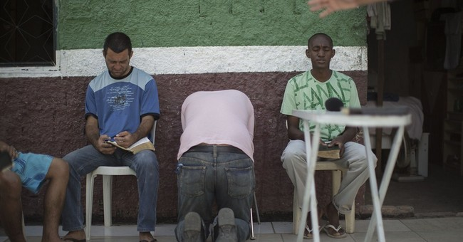 AP PHOTOS: Brazil preachers minister to addicts