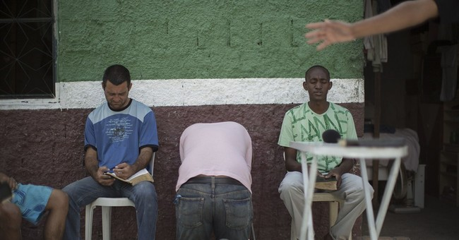 AP PHOTOS: Brazil preachers minister to addicts