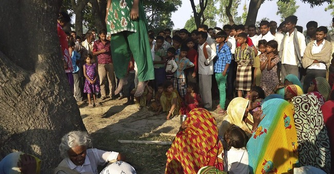 Village protests rape, killings of Indian sisters