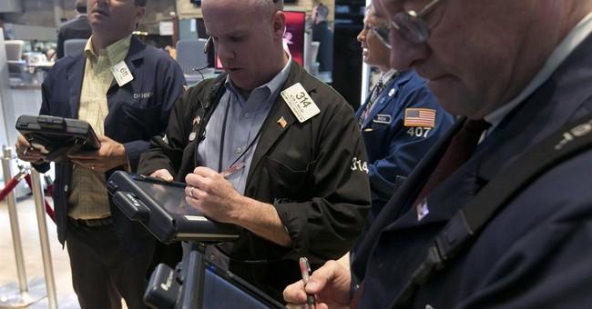 Dow average creeps to a record-high close