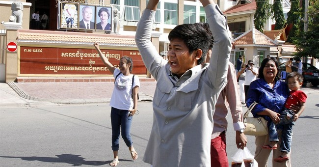 Cambodia convicts labor activists, then frees them