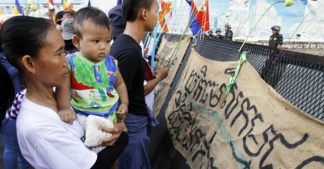 Cambodia convicts labor activists, then frees them