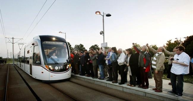 Edinburgh's problem-plagued tram system opens