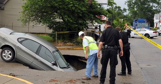 Indiana sinkhole swallows car carrying 4 people