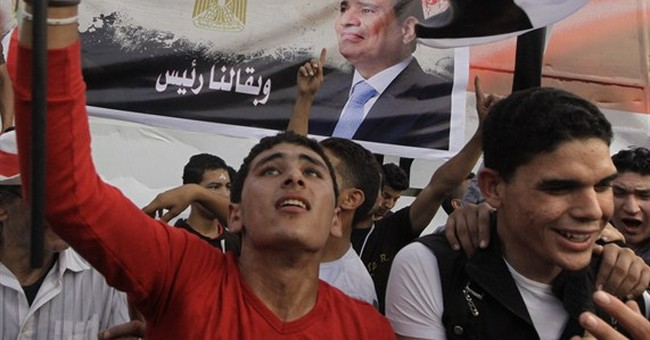 Egypt criminalizes dishonoring anthem, flag