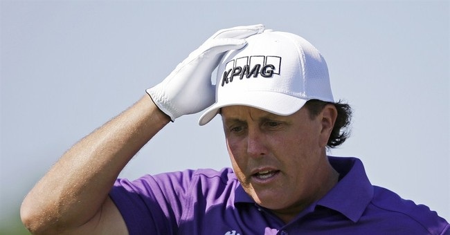 Mickelson says he's cooperating in trading probe