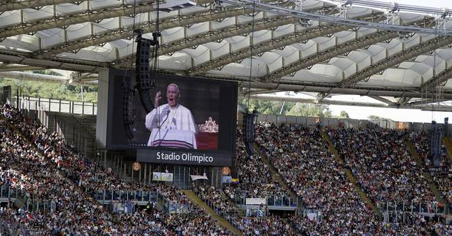 Pope to packed stadium: families are under attack