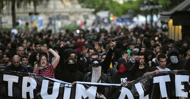 7 arrests as hooded youths clash with Spain police