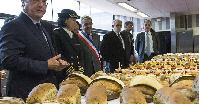 France hosts dueling dinners for Obama, Putin