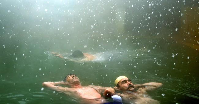 AP PHOTOS: Iran mineral baths offer relief