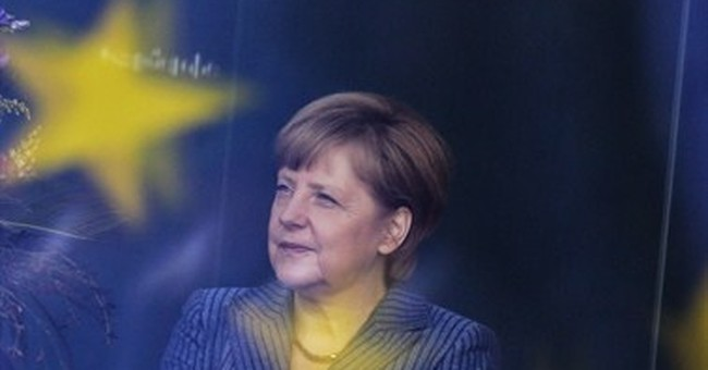 Merkel seeks unity as Europe argues over EU job