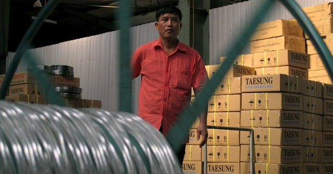 As sabers rattle, Vietnamese businesses fret