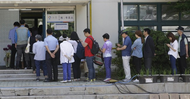 South Koreans vote following ferry sinking