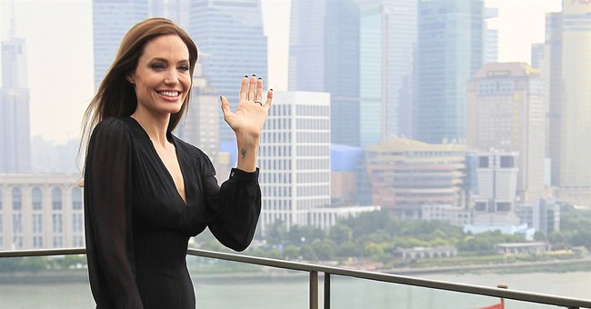 Jolie: We won't change our security on red carpet