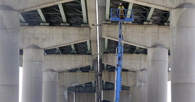 Massive dirt pile may have led to bridge closure