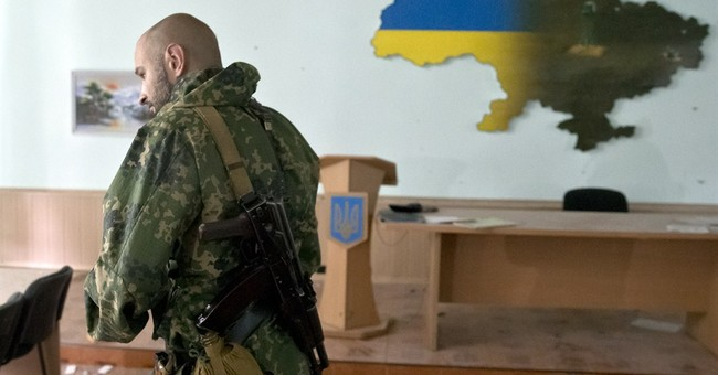 Rebels seize 3 government bases in eastern Ukraine