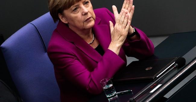 Merkel prods Putin to be more helpful in Ukraine