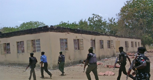 Wearing disguise, Boko Haram slaughters hundreds