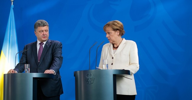 Russian, Ukrainian leaders talk amid D-Day pomp