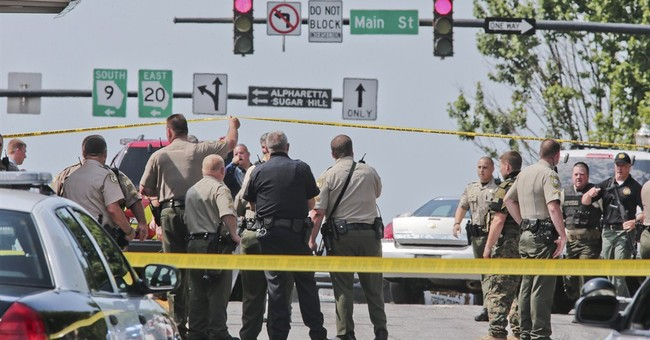 Man attacks outside Ga. courthouse, wounds deputy