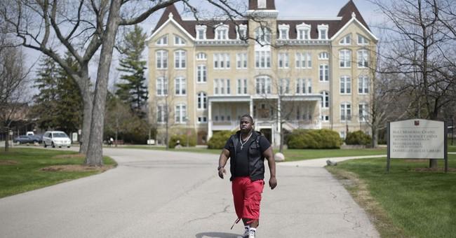 Inner-city school applauds first college graduates