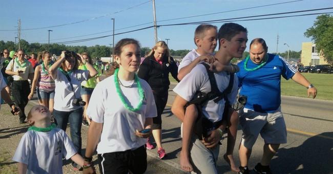 Michigan teen begins 40-mile trek carrying brother