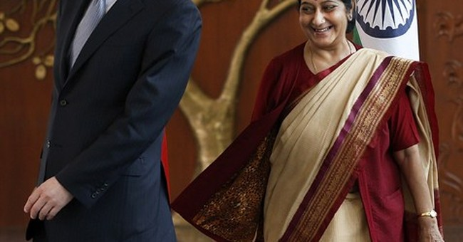 China's foreign minister visits new Indian leaders