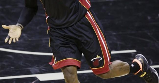 James carries Heat past Spurs to tie NBA Finals