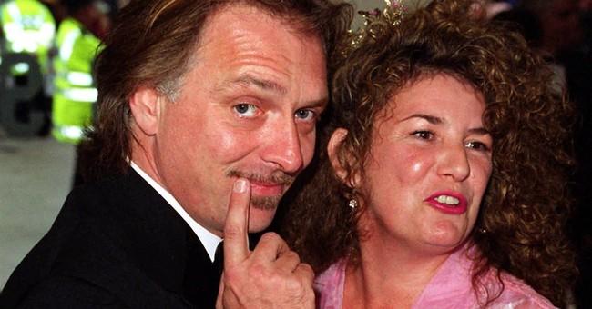 British comedian Rik Mayall dies at 56