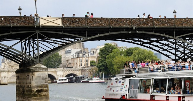 Love locks cause fencing to tumble on Paris bridge