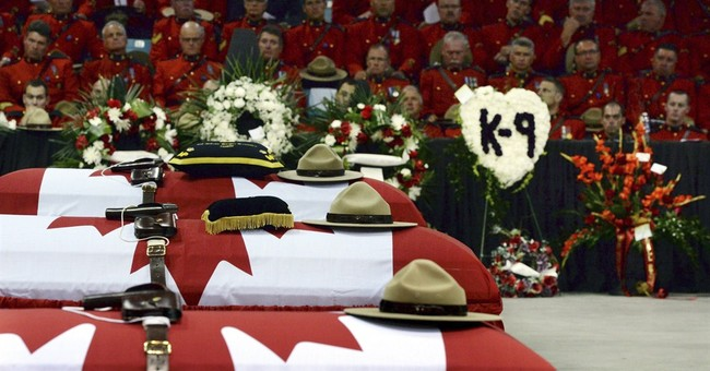Thousands attend funeral for 3 Mounties officers