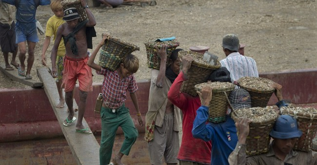 Hauling gravel: Daily toil for Myanmar boy, 11